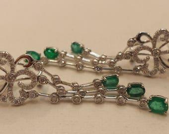 18 K white gold diamond and natural emerald dangle earring