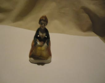 Vintage Porcelain Woman in Dress Sitting On Stump Figurine , collectable