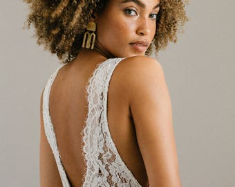 The Laurel • A timeless lace wedding gown with a plunging neckline + deep-v back.