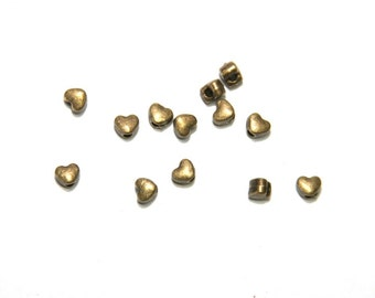 25 Pcs. small metal beads heart tib. Style color: bronze MP047