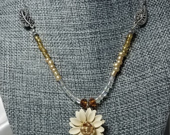 Cream Colored Flower With Gold Bead and Silver Leaf Accent Necklace