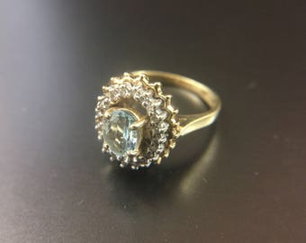 14K yellow gold ring with blue topaz and diamond halo, size 5, weight 4.4 grams