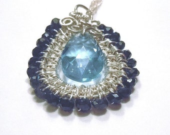 Silver, black and blue pendant