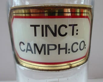 Large Antique Clear Glass Chemist Bottle. TINCT: CAMPH CO with Original Foil Label and Ball Stopper. 9 1/2 inches