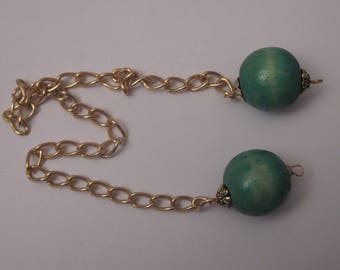 2 large beads in green color wood with gold chain and bead caps (PB1-3)
