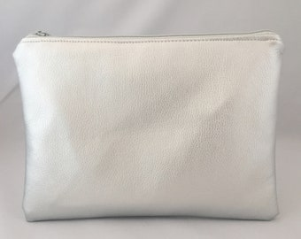 Nappy clutch/pouch made in Silver metallic faux leather. wash bag, travel bag, zippered bag, nappy bag. Gender neutral. Bright