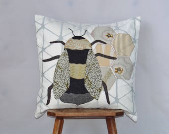 Bee cushion - handmade using applique with recycled fabrics
