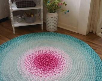 Pink and misty mint braided rug aqua