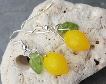 Lemon Drop earrings - semi translucent, bright yellow glass lemon beads with green glass leaves