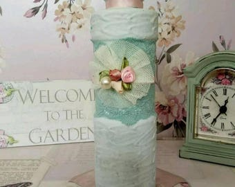 A Hand Painted Shabby Chic,Embossed Glass Bottle with Duck egg blue lace and satin roses