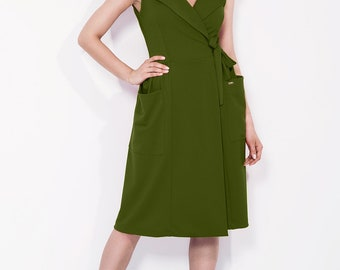 Green envelope dress with a bow and big pockets