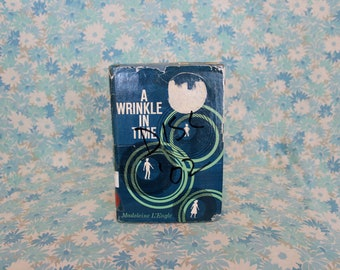 A Wrinkle In Time by Madeleine L'Engle.RARE 1966 First Edition 13th Printing Hardcover. Wrinkle In Time Trilogy.Childrens Fantasy Novel Book