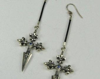These Hand Made Sterling Silver Fleur De Lis Dagger drop earrings.
