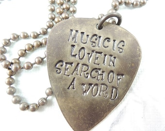 Music is Love in Search of a Word - Hand Stamped brass pendant necklace, Guitar Pick Necklace