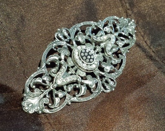 Sterling silver vintage brooch with inlaid crystal