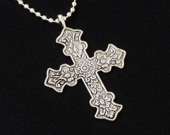 Ornate Large Silver Cross necklace / pendant with floral designs .