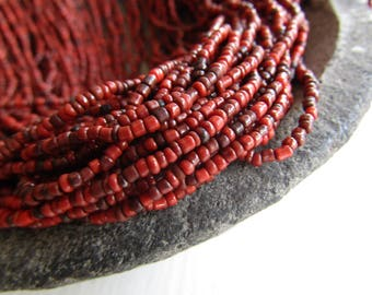 MINI  red glass seed beads, rustic opaque delicate spacer  tube barre, irregular shape Indonesian - 1 to 2mm (44 inches std) 7ab1-4
