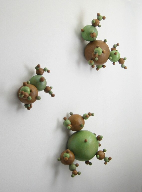 abstract molecular ceramic wall art in rust orange and stone green