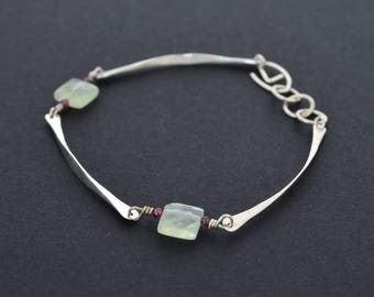 Elegant silver forged simple contemporary dainty bracelet with a boho twist. handmade everyday jewelry .Green Phrenite and garnet gemstones