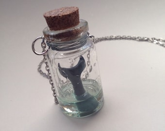 Whale Tail in a Bottle