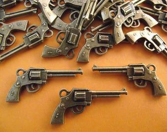 Set of 4 pistol, revolver, bronze charms. 3.5 cm x 1.6 cm.