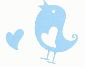 Scrapbooking cutting bird with heart