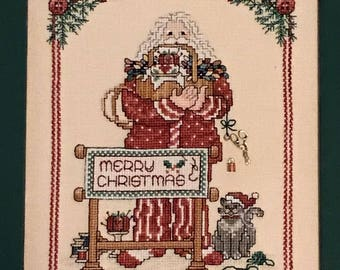 Santa holding sewing basket