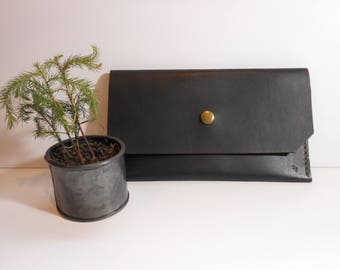 Black Vegetable Tan clutch