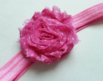 Pink and white polka dot flower baby headband