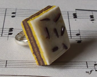 Realistic Neapolitan ring napage, dessert jewelry chocolate delicious kawaii food sculpture.