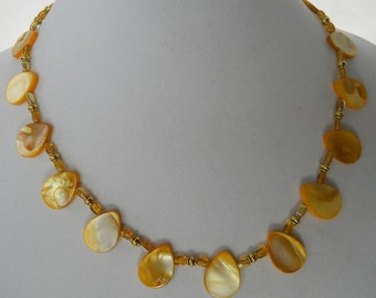 Yellow mother of pearl drops and honey glass square ovals bring the warmth of the sun to this necklace.