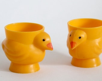 Vintage pair of plastic yellow egg cups in moulded chick shapes, made in Hong Kong
