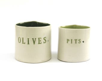 olives and pits  ...  hand built porcelain containers ...  bold green vessels