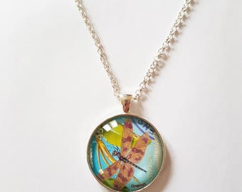 Dragonfly stamp with shimmery wings, 30mm round pendant in silver or antique bronze, includes complimentary chain