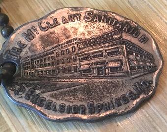 Vintage McCleary Sanitarium metal key fob! Excelsior Springs Mo.
