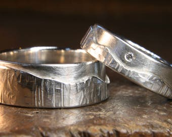 """Set of Walk On The Hills """"Multi-Textured"""" hammered wedding rings. Ethical recycled sterling silver, moissanite, Hand made in the UK."""