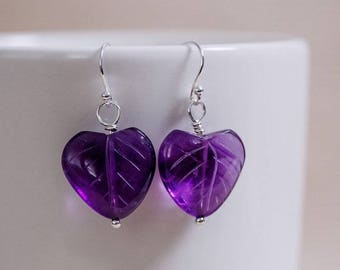 Thick, dark purple genuine amethyst in heart shape with carved leaf detail. All sterling silver components.