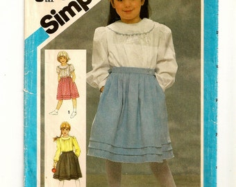 """A Pleated Wrap Skirt & Long or Short Sleeve Blouse Sewing Pattern with Collar Variations: Uncut - Girls Size 6, Breast 25"""" • Simplicity 6558"""