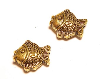 20% OFF -- Six (6) Antique Goldtone Fish Spacer Beads