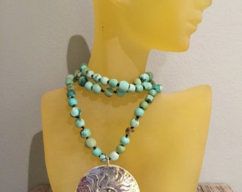 Turquoise beaded necklace with sterling silver pendant