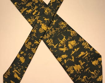 Vintage GCS motifs green and gold Safari animals Terelyne tie made in England