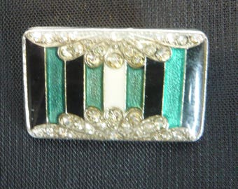 Small brooch in resin