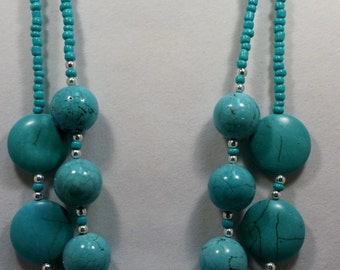 Turquoise beaded double strand necklace and earring set.