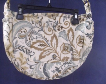 Hand Made shoulder bag made out of a heavy weight cotton fabric Has a pocket on the front side pockets on each side and a pen pocket inside.