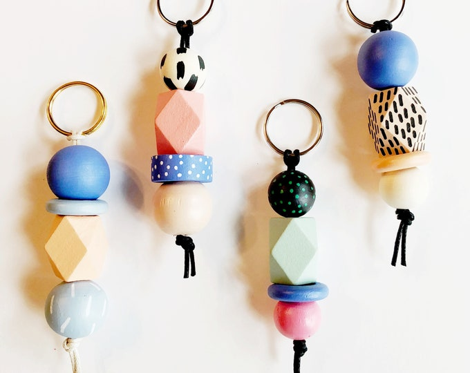 Featured listing image: The Keychain to Happiness | Handpainted wooden bead keychain