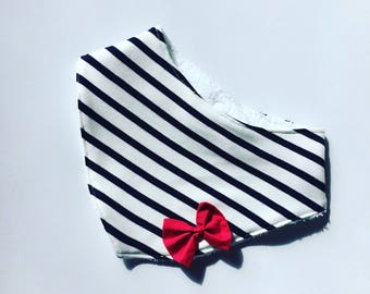 Red sailor bib with a bow decoration. French manufacturing