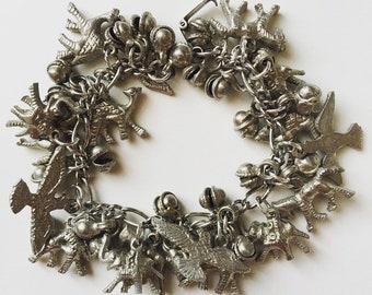 Vintage animal charm heavyweight Tibetan sterling silver bracelet