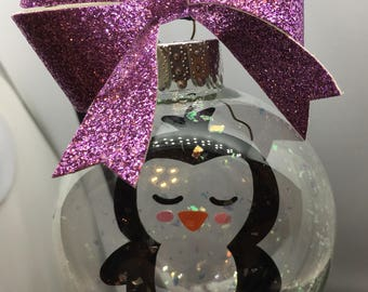 Snowy penguin ornament with bow