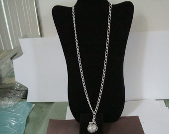 SILVER COLORED BALL pendant hangs on a 27 inch silver colored chain. See photos and description area.