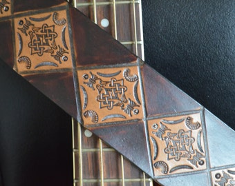 """Earth tones on this dark/light brown guitar strap. Unique, hand tooled diamond pattern. Supple and durable. AKA """"Geometron:."""
